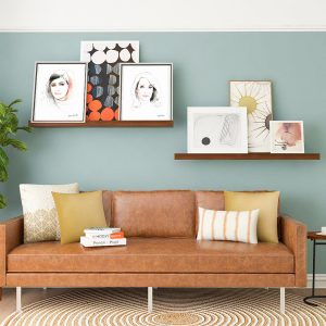 Sofa with a collection of Frames by Kalika Yap's Little Brand Book