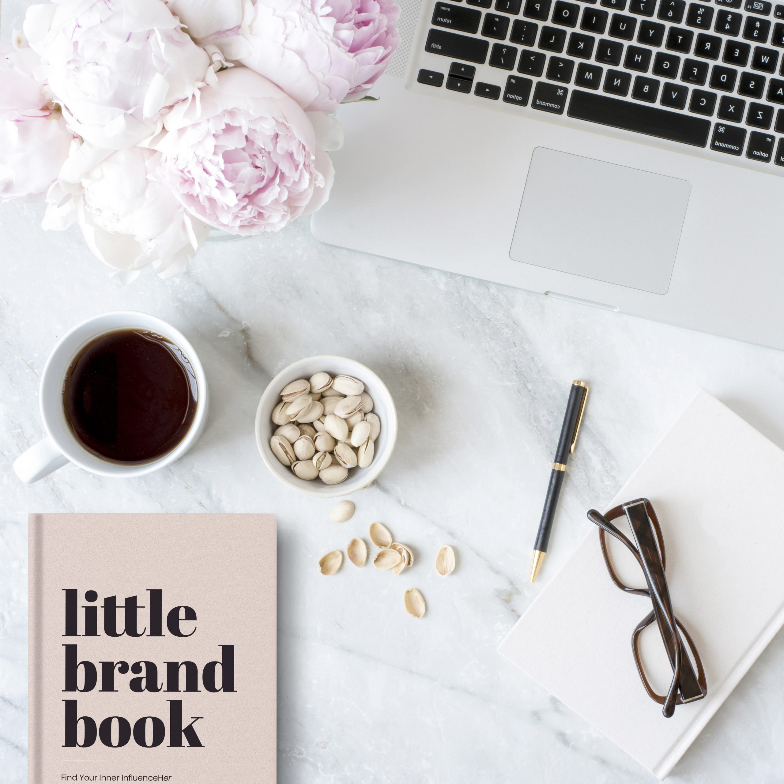 Kalika Yap's Little brand book on table with coffee, eyeglass, and laptop