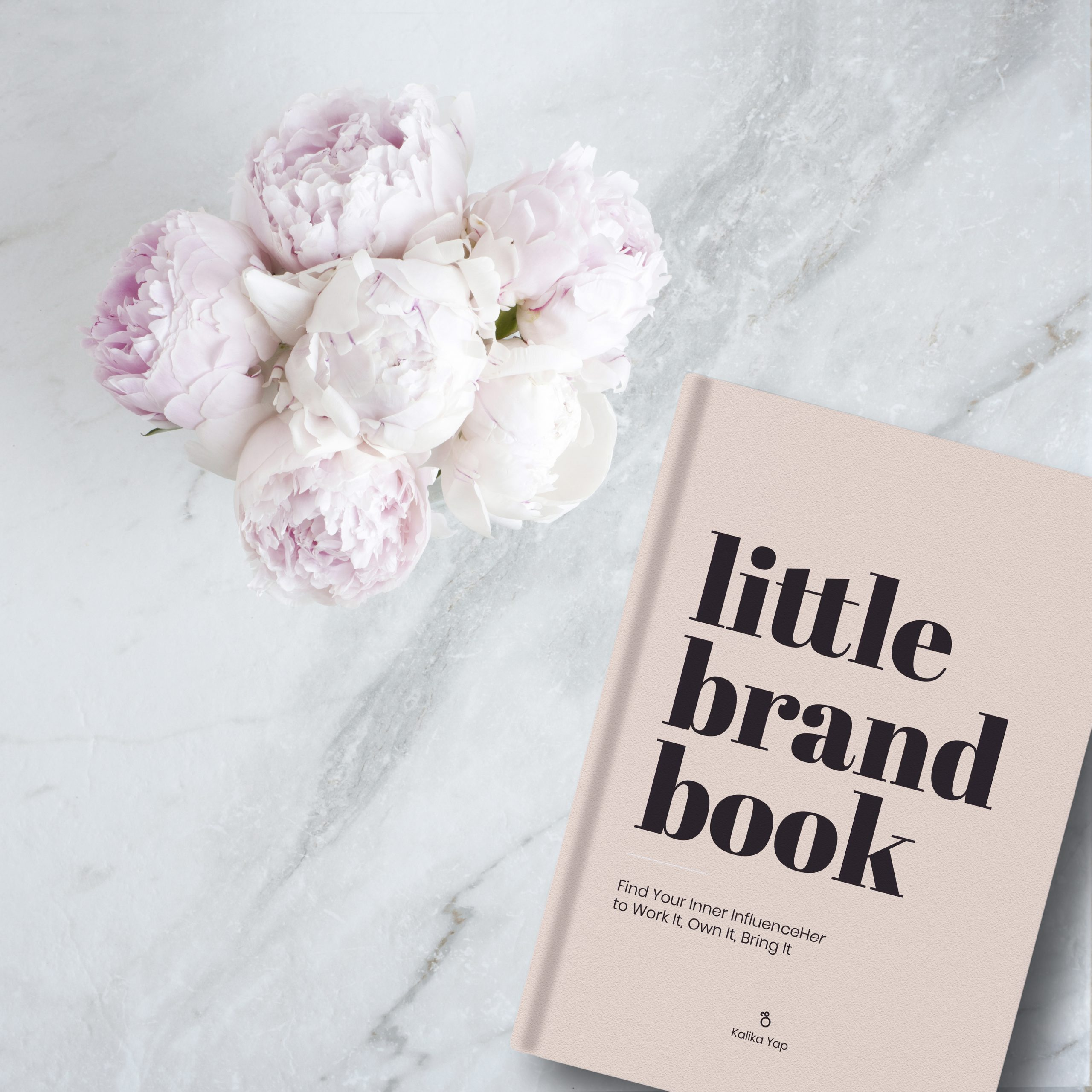 Kalika Yap's Little brand book on table with flowers